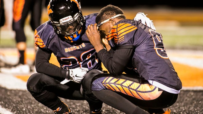 Northeastern's Frank Brown (28), left, consoles his teammate Michael Cooper (9) after a heartbreaking 25-24 loss to Cocalico in a PIAA District 3 5-A quarterfinal football game Friday, Nov. 11, 2016, at Northeastern Senior High School in Manchester Township. Amanda J. Cain photo