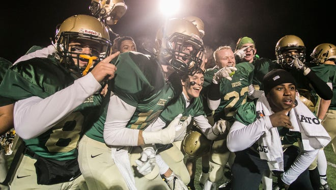 York Catholic players celebrate after defeating Newport 51-21 in the District 3 2-A championship game at Boiling Springs High School last weekend. The Fighting Irish will face District 2-champion Dunmore in the first round of the state tournament on Friday night. Amanda J. Cain photo