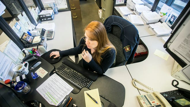 Collections manager Sarah Morin, of Dover, reviews follow-ups  Wednesday Dec. 14, 2016, at the Clerk of Courts office in the Judicial Center. Amanda J. Cain photo
