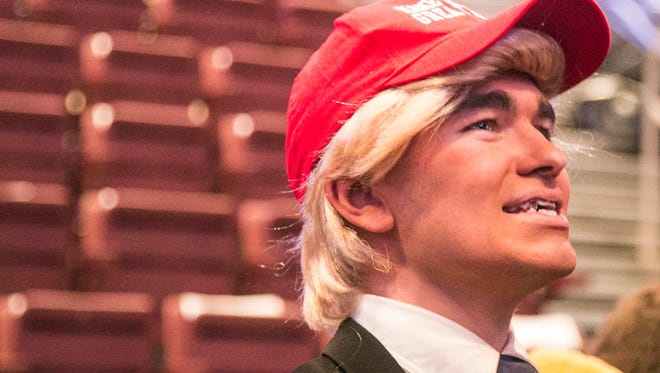 Vincent Devlin, 18, of York City, dressed in full Trump attire, awaits the start of President-elect Donald J. Trump and Vice President-elect Mike Pence's Thank You Tour Rally  Thursday, Dec. 15, 2016, at the Giant Center in Hershey. Amanda J. Cain photo