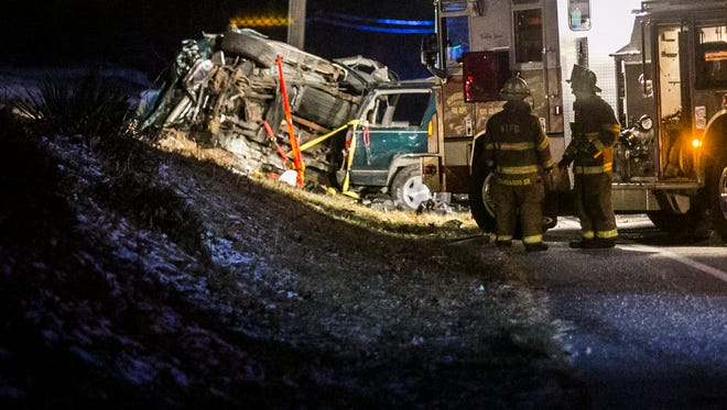 Firefighters respond to a fatal car accident on Old Trail Road Saturday, Jan. 7, 2017, in Newberry Township. Amanda J. Cain photo