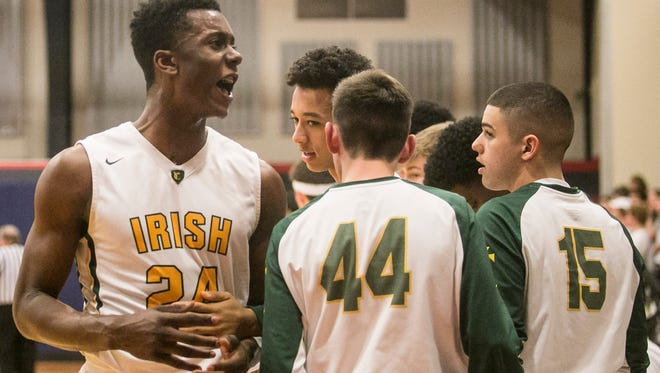 York Catholic's Melik Martin (24) and some of his teammates are shown here during this past season. The Fighting Irish and Delone Catholic are the two private schools in the York-Adams League. The topic of transfers, especially from public schools to private schools, has become a major topic of conversation.