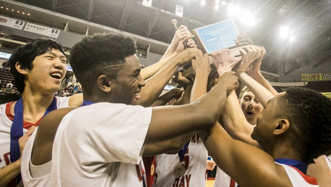 York Country Day players celebrate after defeating Lancaster County Christian 85-58 in the District 3 Class 1-A boys' basketball championship game Thursday, March 2, 2017, at the Giant Center in Hershey. The school has announced that Chris Charleston will be the boys' head coach next season. Charleston took over the boys' program in the middle of last season on an interim basis.