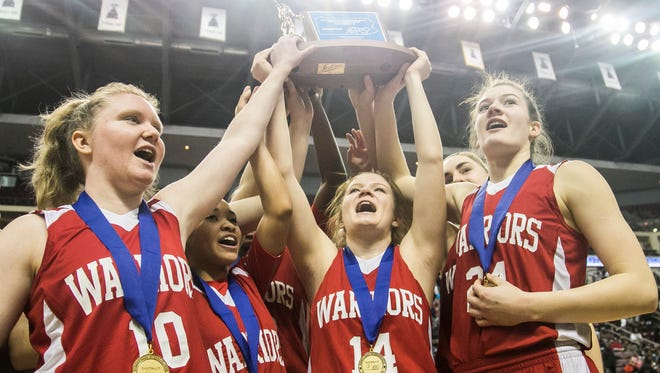 Susquehannock's Maggie Sisler (10), Jayla Galbreath (23), Taylor Tanura (14), Tyler Williams (24) and their teammates hoist the District 3 Class 5-A girls championship trophy after defeating Harrisburg, 44-42,  Saturday, March 4, 2017, at the Giant Center in Hershey. The Warriors won the program's first ever district title this season, one of four York County schools to capture district gold this year. Amanda J. Cain photo