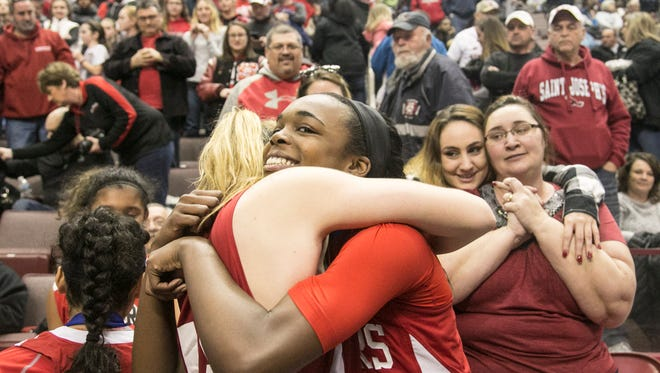 Susquehannock's Jaden Walker (22), hugs teammate Anna Mahan (45), after defeating Harrisburg 44-42 in the District 3 Class 5-A girls championship game in 2017. Walker was named the Division II Player of the Year by the York-Adams League coaches. DISPATCH FILE PHOTO