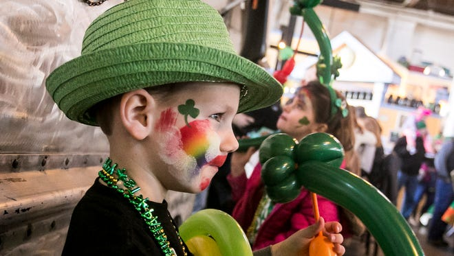 Declan Lauber, 5, of Manchester Township, shows off his face paint as he watches an Irish dance performance at Central Market before the 34th Annual York Saint Patrick's Day Parade, Saturday, March, 11, 2017. Amanda J. Cain photo