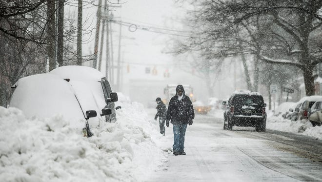 An unidentified man walks Linden Ave., during Winter Storm Stella Tuesday, March, 14, 2017. Amanda J. Cain photo