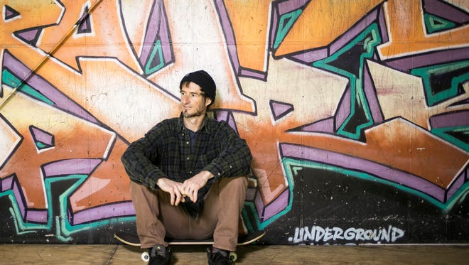 Aaron Wilson, of New Cumberland, sits in front of a graffiti wall at the Underground Skatepark Thursday, March, 23, 2017,  in Dillsburg. Amanda J. Cain photo