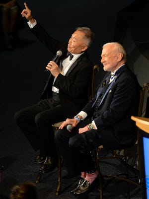 George Takei and Buzz Aldrin talk about space during Saturday's ShareSpace Foundation Gala in the Apollo/Saturn V Center at Kennedy Space Center.