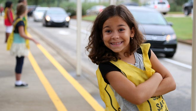 Despite heavy traffic and a few sprinkles, families were all smiles at Greenbrier Elementary School in Greenville for the first day of the new school year Aug. 18, 2015