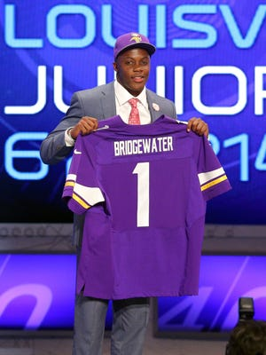 May 8, 2014; New York, NY, USA; Teddy Bridgewater (Louisville) is introduced as the thirty second overall pick in the first round of the 2014 NFL draft by the Minnesota Vikings during the 2014 NFL draft at Radio City Music Hall. Mandatory Credit: Brad Penner-USA TODAY Sports