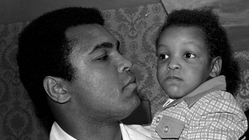 FILE - In this April 15, 1975 file photo, Heavyweight boxing champion Muhammad Ali, and Little Muhammad Ali, his 2 1/2 year old son, arrive at Miami Beach, Fla. Muhammad Ali's son, who bears the boxing great's name, was detained by immigration officials at a Florida airport and questioned about his ancestry and religion in what amounted to unconstitutional profiling, a family friend said Saturday, Feb. 25, 2017.