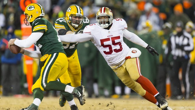 San Francisco 49ers linebacker Ahmad Brooks (55) chases Green Bay Packers quarterback Aaron Rodgers (12) during the third quarter of a 2013 NFC wild-card playoff game at Lambeau Field.