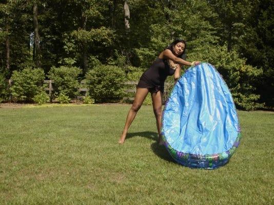 WATER SAFETY-MOM DUMPING KIDDIE POOL_jpg.jpg