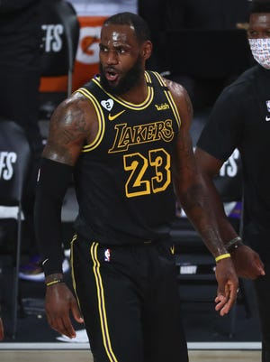 Aug 24, 2020; Lake Buena Vista, Florida, USA; Los Angeles Lakers forward LeBron James (23) reacts after scoring in the first half against the Portland Trail Blazers in game four of the first round of the 2020 NBA Playoffs at AdventHealth Arena. Mandatory Credit: Kim Klement-USA TODAY Sports