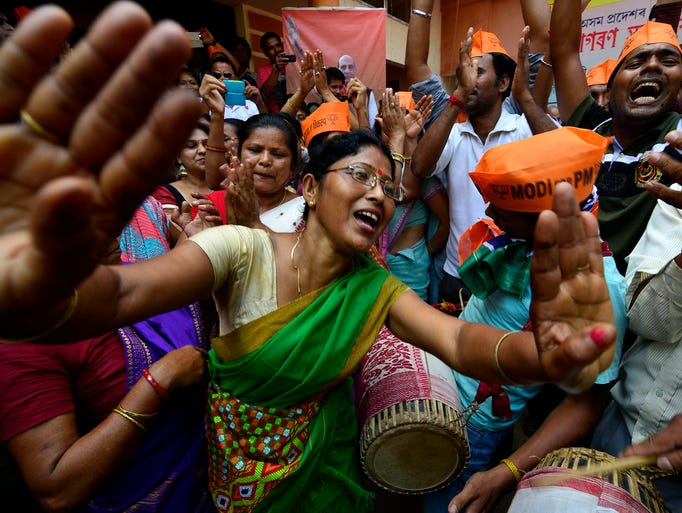 Supporters of the Bharatiya Janata Party celebrate their party's national election victory and for its prime minister candidate Narendra Modi on May 16 in Guwahati, India. Modi's Hindu nationalist party has won an absolute majority in India's parliamentary election.