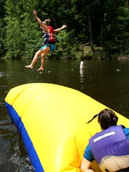 Deer Run Retreat campers are blobbed into a lake during