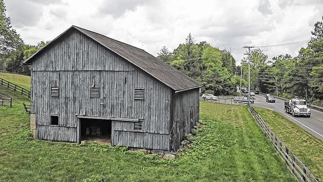 This barn at state Route 315 and Jewett Road, estimated to have been built in the 1850s, could be threatened by the Ohio Department of Transportation's plans for a roundabout or other options to ease backups at the intersection. ODOT's proposals have led to frustration for some area residents and history buffs.