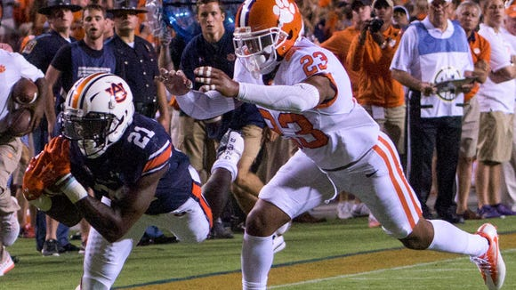 Auburn running back Kerryon Johnson (21) can't control the ball on an incomplete pass against Clemson safety Van Smith (23) at Jordan-Hare Stadium in Auburn, Ala., on Saturday September 3, 2016.