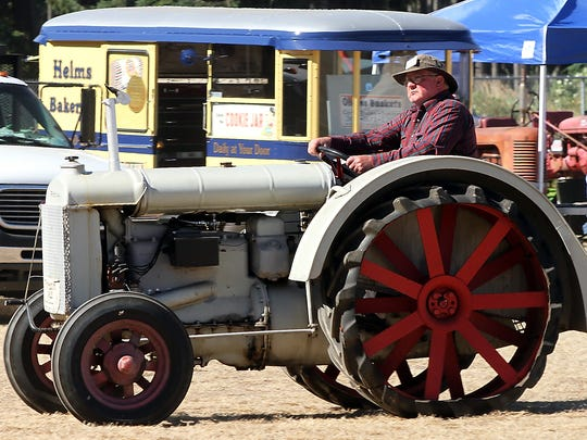 A driver moves his tractor into position at Saturday's Olympic Peninsula Antique Tractor and Engine Association's tractor pull and swap meet in Port Orchard.