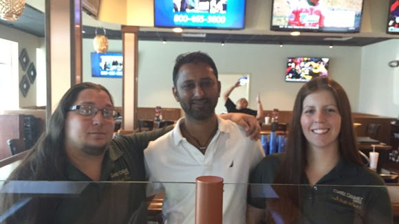 Claudio Monar, Maulik Shah and Brittany Suarez are excited about opening the Copper Chimney in Palm Bay.