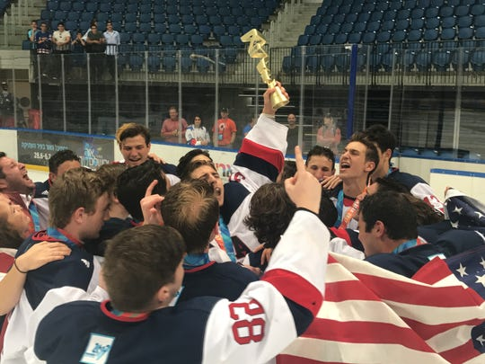 Team USA celebrates its junior hockey Gold Medal victory at the 20th Maccabiah Games.