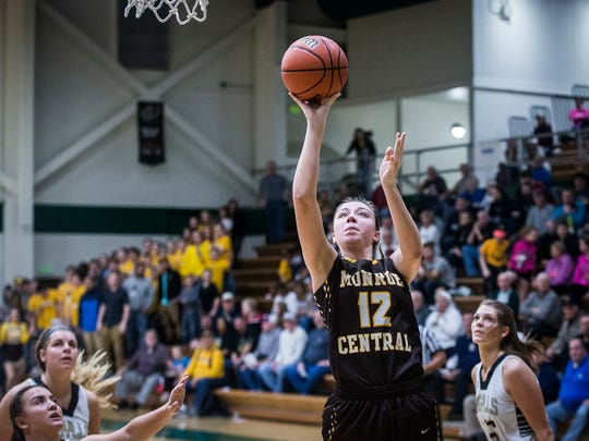 Monroe Central's Jordyn Barga shoots past Madison-Grant's defense during their game at Eastern High School in Greentown Saturday, Feb. 11, 2017.