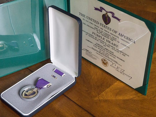 The Purple Heart, earned by Cpl. James Ross, missing in action in South Korea.