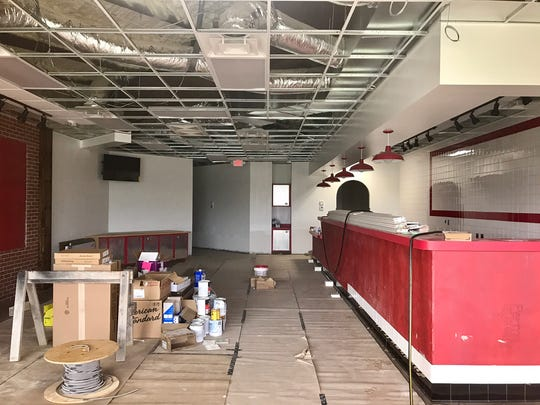 Work continues on the interior of Firehouse Subs.