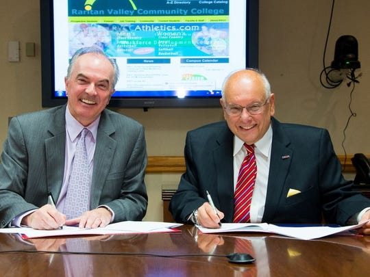 RVCC President Michael J. McDonough, left, and FDU President Sheldon Drucker sign a new Dual Admission Agreement, Oct. 7, at RVCC's Branchburg  Campus