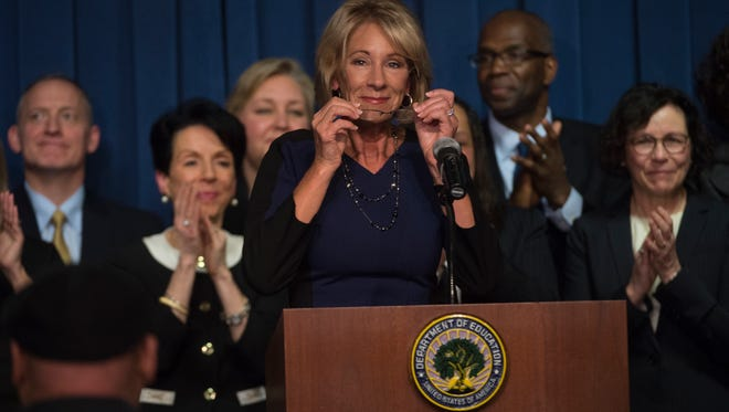 Education Secretary Betsy DeVos is applauded after addressing the department staff at the Department of Education on Wednesday, Feb. 8, 2017 in Washington. (AP Photo/Molly Riley)