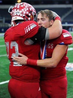 Sweetwater defensive lineman Tate Rainey (72) consoles teammate Luke James (7) after Sweetwater's 24-6 loss to West Orange-Stark in the Class 4A Div. II state championship game on Friday, Dec. 16, 2016, at AT&T Stadium in Arlington.