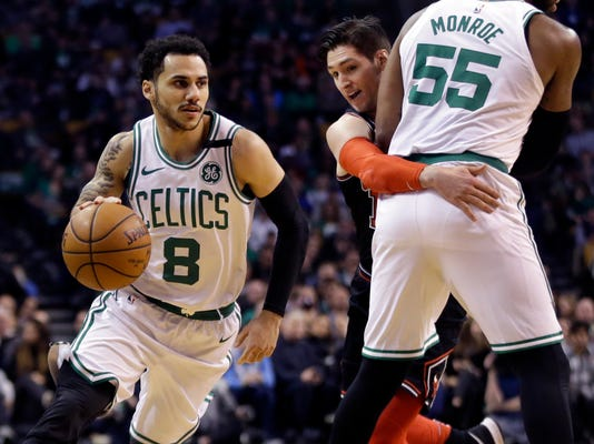 Boston Celtics guard Shane Larkin (8) drives as Chicago Bulls guard Ryan Arcidiacono cannot get through a pick by Celtics center Greg Monroe (55) in the first half of an NBA basketball game, Friday, April 6, 2018, in Boston. (AP Photo/Elise Amendola)