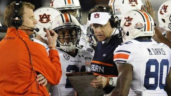 Gus Malzahn took the high road in reaction to Arkansas coach Bret Bielema saying his team didn't have any suspensions.