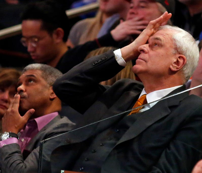 New York Knicks president Phil Jackson and general manager Steve Mills look on during the second half against the San Antonio Spurs at Madison Square Garden.