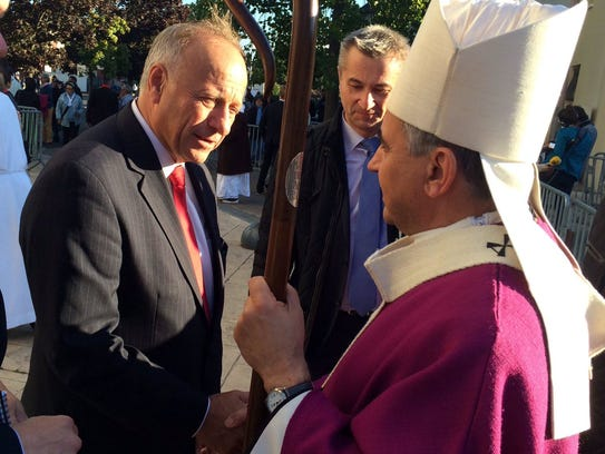 Steve King greets Archbishop Dominique Lebrun on Oct.