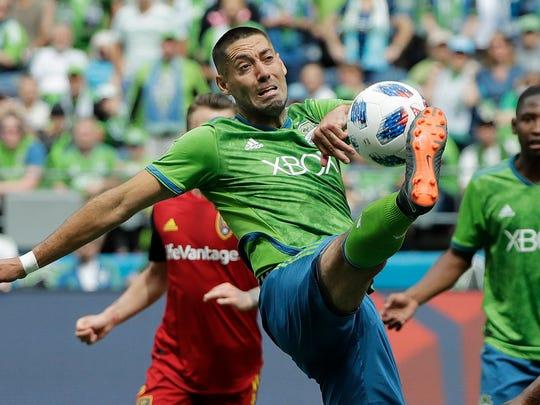 Seattle Sounders forward Clint Dempsey kicks the ball