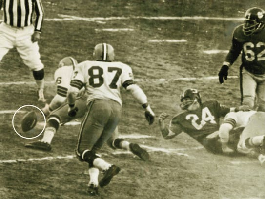 Ray Nitschke makes one of his two fumble recoveries