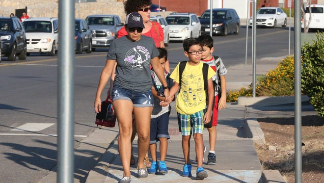 Parents drop off their children at Tippin Elementary School in West El Paso Tuesday morning. On the first day of school, a Texas mother  was killed after she was hit by a car in the school's parking lot.