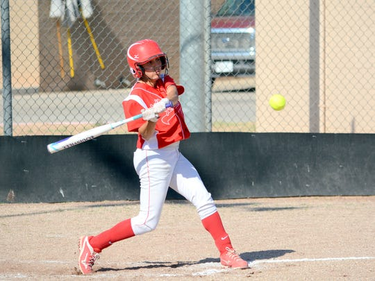 Loving's Alyssa Carrasco makes contact at the plate in game one Tuesday against Eunice.