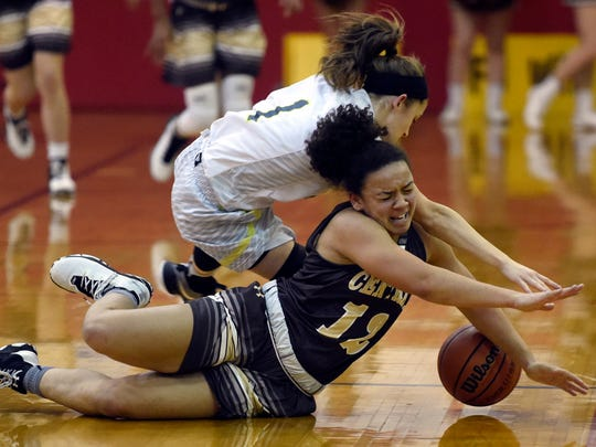 Mykiah Jones of Central dives for a loose ball after poking it away from Anna Newman of North during the second quarter of the SIAC girls championship at  Harrison High School Saturday.  Central claimed its third straight SIAC championship with a 44-37 win over North.