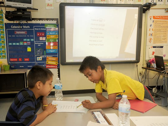 Students Alexis De La Cruz(left) and Gustavo Mendez work together during a class in the third/fourth grade newcomer program at McKinna School in Oxnard.