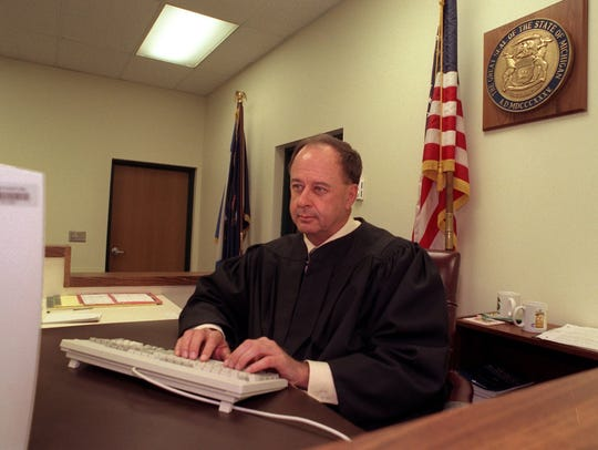 30th Circuit Court Judge William Collette, uses a computer