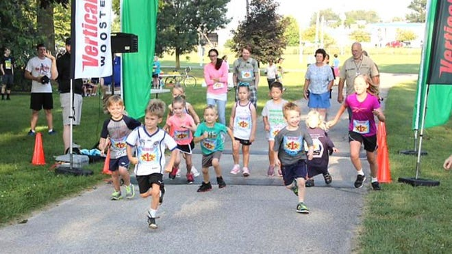 1K runners take off at the start of the 2019 1K Fun Run. This year's Ohio Mennonite Relief Sale Run 4 Relief 1K and 5K will be vitural runs due to the Covid-19 pandemic.