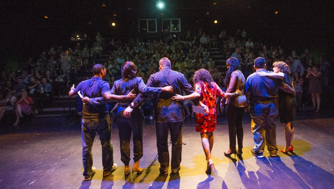 """Storytellers and hosts take a bow after the end of the Storytellers Project """"I am an American"""" storytelling event at Phoenix Theatre June 14, 2017."""