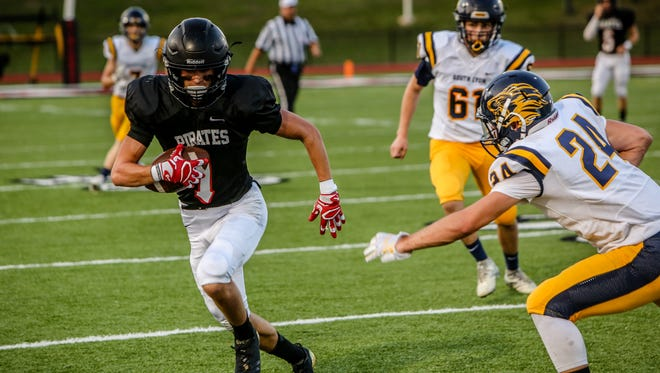 Pinckney's Nick Cain had three touchdown catches, returned a kick for a touchdown, threw for a touchdown, had a 2-point catch and intercepted a pass in a 45-30 victory over South Lyon.