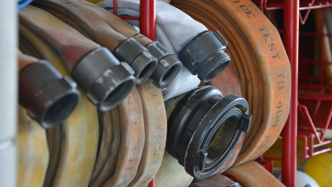 Fire hoses sit coiled and ready for use in this file photo.
