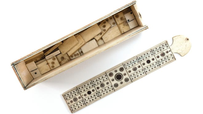 Napoleonic prisoners made this bone game box with a sliding top. It held a cribbage board and 26 dominoes.
