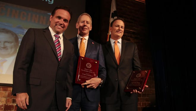 City of Cincinnati Mayor John Cranley, left, awards FC Cincinnati Owner & CEO Carl H. Lindner III, center, and President & General Manager Jeff Berding, right, Cincinnati of the Year awards during the 2016 State of the City speech, Tuesday, Oct. 4, 2016, at the 20th Century Theater in Oakley.