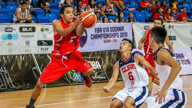 In this December 2016 file photo, Valentin Alexandre of New Caledonia handles the ball against Guam in the FIBA U18 Oceania Championship for Men in Suva, Fiji.